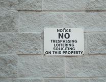 A sign forbidding soliciting. On the wall stock photos