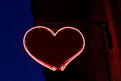 Sign in the form of red heart from neon royalty free stock photos