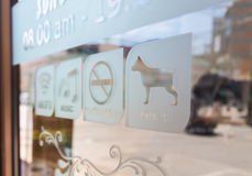 Sign  (Free Wifi,Music,No smoke,Pet in) Stock Photography