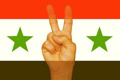 Sign of freedom on the fingers. The Syrian flag. royalty free stock photography