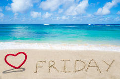 Sign. Friday with heart on the sandy beach by the ocean Royalty Free Stock Photo