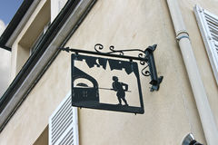 A sign on the front of the house in Chartres, Royalty Free Stock Photo