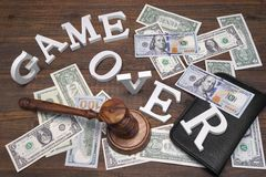 Sign Game Over, Doolars Cash, Judges Gavel On Wood Background Stock Photo