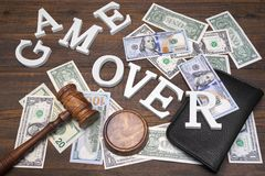 Sign Game Over, Doolars Cash, Judges Gavel On Wood Background Stock Photos