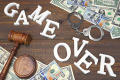 Sign Game Over, Money, Handcuffs, Judges Gavel On Wood Backgroun Stock Images