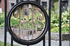 Sign on the gate to the cemetery Stock Photos