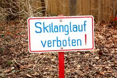 Sign with german words Cross-country skiing prohibited Royalty Free Stock Photo