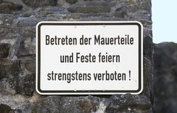 Sign in Germany, it says Stepping on walls and partying strictly forbidden.  stock image