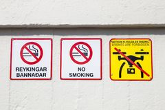 A no smoking or drone sign. A sign at Geysir in Iceland which forbids smoking and drones at the park royalty free stock image