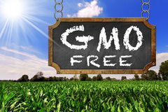 Sign of GMO Free on a Corn Field Stock Photos