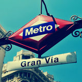 Sign of Gran Via metro station in Madrid, Spain, with a retro ef Stock Photos