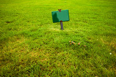 Sign in the grass Stock Photos