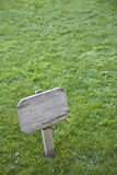 Sign on the grass. A sign on a green field Royalty Free Stock Photos