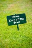 Sign on grass Stock Photos