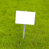 Sign on grass Stock Photography