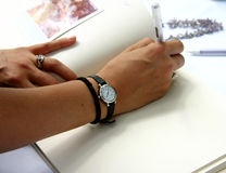 Sign The Guest Book. Signing the guest book at the wedding Royalty Free Stock Photography