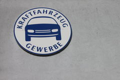 Sign of guild. Sign of the automobile guild in Germany on a house front. In this shool trainees get ther skills for the job in the german automobile buisiness Royalty Free Stock Photos