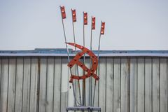 Sign, the hammer and Sickle, USSR, farm, abandoned. Image stock photos