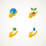 Sign with hand holding elements Earth, heart. Sign or logo with hand holding elements Earth, heart, sprout, water drop. Vector illustration. Think green concept Stock Photo