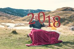 2018 sign in the hands of a senior caucasian man and little boy Royalty Free Stock Image