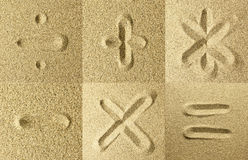 Sign handwritten in the sand. Mathematical signs Royalty Free Stock Photos