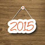 2015 sign hanging on a wood plank Royalty Free Stock Photography