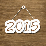2015 sign hanging on a wood plank Royalty Free Stock Photos