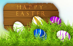 Sign of a happy Easter and Easter eggs. Royalty Free Stock Photography