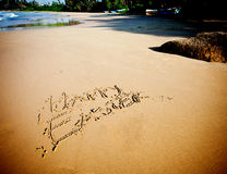Sign Happy Easter sandy beach by the ocean Stock Photography