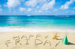 Sign. Happy Friday on the sandy beach by the ocean Stock Photography