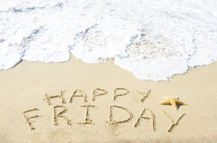 Sign. Happy Friday on the sandy beach by the ocean Royalty Free Stock Photography