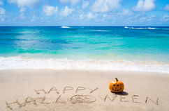 Sign. Happy Halloween with pumpkin on the beach Stock Image