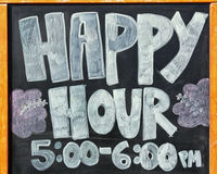 Sign for happy hour. A sign for happy hour five to six pm Stock Photography