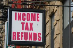 Income Tax Refunds. A sign in Harlem, New York City, that reads Income Tax Refunds stock image