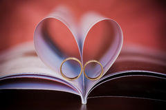 Sign of a heart and beautiful golden rings Royalty Free Stock Images