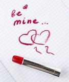 Sign on heart in a notebook and red lipstick in Valentine's Day Royalty Free Stock Image