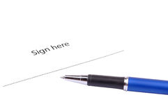 Sign here. With pen on isolated background Royalty Free Stock Photos