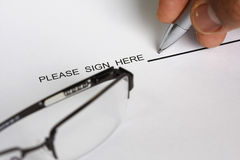 Sign here. Concept - many uses for documents and legal matters Stock Image