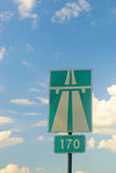 Sign of the highway against the sky Stock Photo