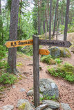Sign with hiking trails in a forest Stock Images
