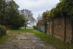 Sign of the Hillingdon Trail near the walls of the Stable Block in Cranford Park