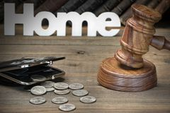 Sign Home, Gavel, Purse And Old Book On Wood Table Stock Images