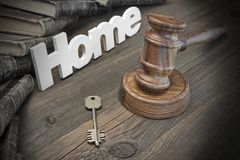 Sign Home, Key, Judges Gavel And Book On Wood Table Royalty Free Stock Images