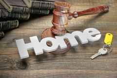 Sign Home, Key, Judges Gavel And Book On Wood Table Stock Photography