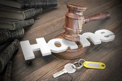 Sign Home, Key, Judges Gavel And Book On Wood Table Royalty Free Stock Image