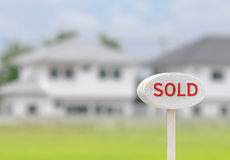 Sign home sold. On house background royalty free stock photos