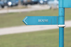 Sign: House word. On Blue Guide Post Stock Image