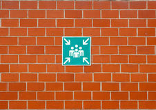 Sign of human group. On brick wall Stock Photos