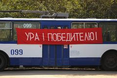 Sign Hurrah for the Victor on red banner on trolleybus. Horizontal Stock Images