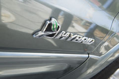 Sign on hybrid car Stock Photo